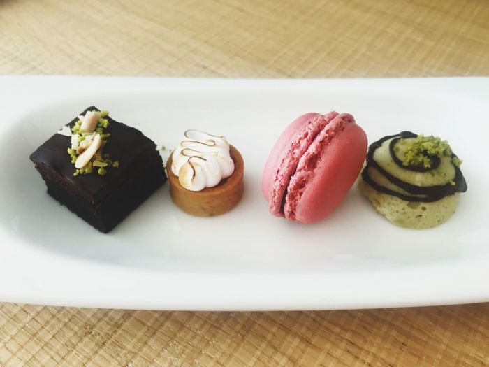 Selection of desert treats on a plate Selection Desert Macarons Food And Drink Food Freshness Ready-to-eat Sweet Food Dessert Temptation Table Indulgence Sweet Plate Unhealthy Eating Serving Size Close-up Cake High Angle View Indoors  Still Life