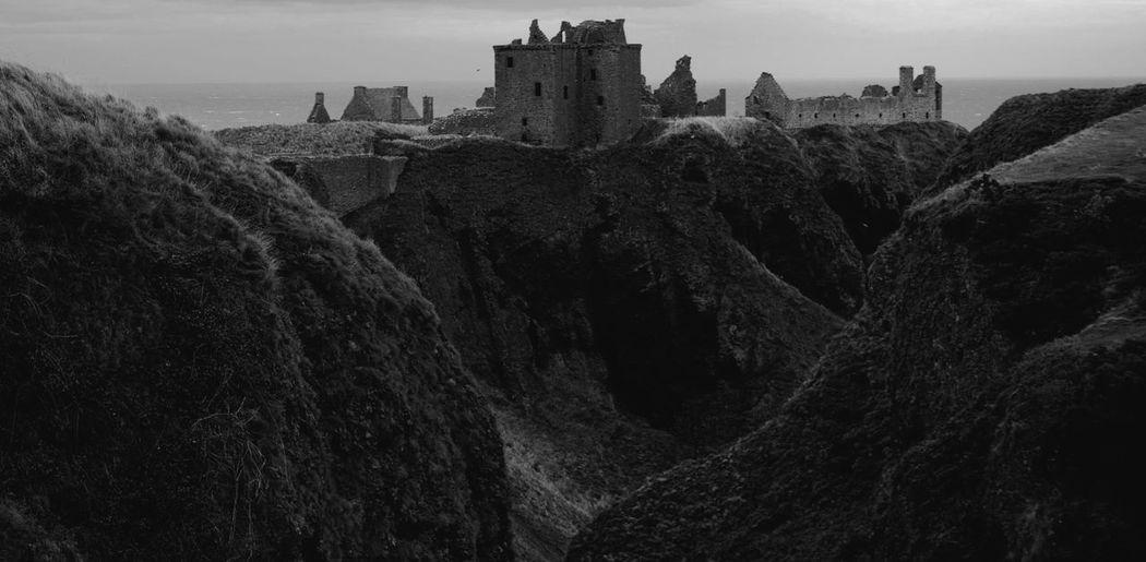 Dunnottar castle on mountain against sky