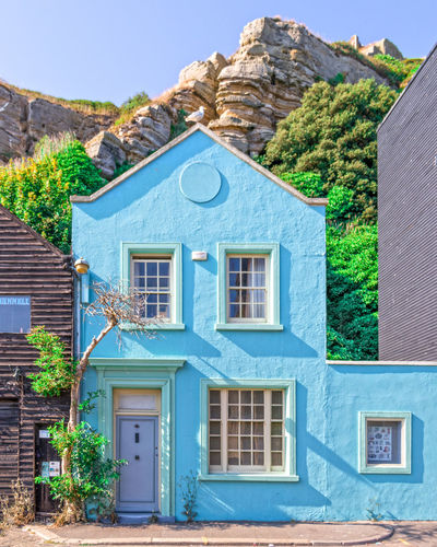 Pretty Blue House Blue House Blue Sky Light Light Blue Old House Stone House Ambient Pastel Seascape Beachphotography Blue Residential Building Window Façade House Whitewashed Door Architecture Building Exterior Built Structure Mountain Historic Cottage Entryway Village Porch