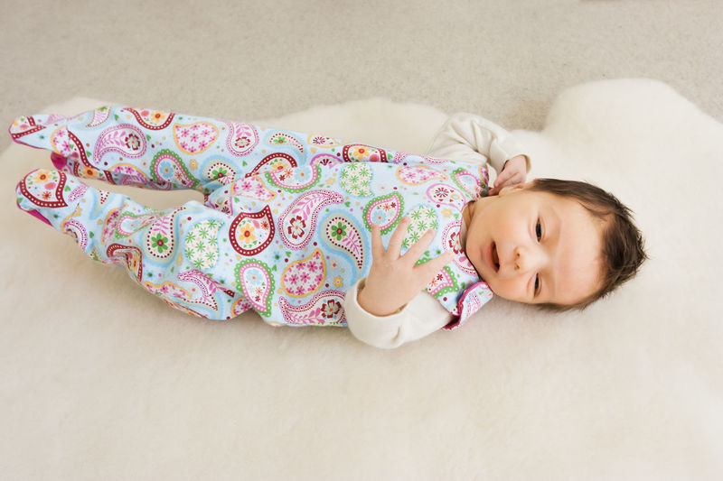 High angle view of cute baby girl sleeping on bed