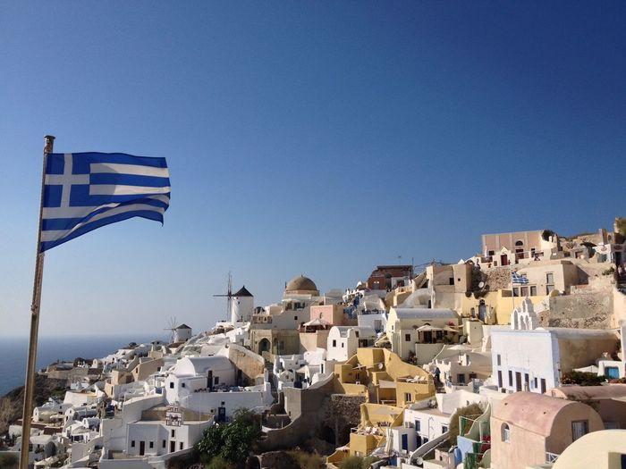 Greek flag waving at oia