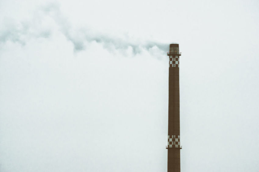 Industrial chimney in Berlin, Germany Air Pollution Architecture Berlin Day Environmental Issues Factory Germany Grey Sky Horizontal Industrial No People Outdoors Sky Smokestack