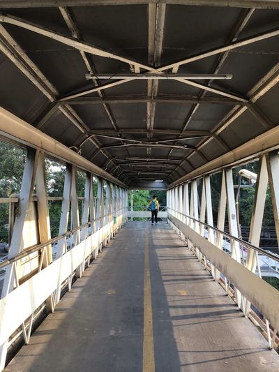 Direction The Way Forward Built Structure Architecture Bridge Transportation Bridge - Man Made Structure Diminishing Perspective Day Men Real People Incidental People Lifestyles vanishing point Sunlight Nature Shadow