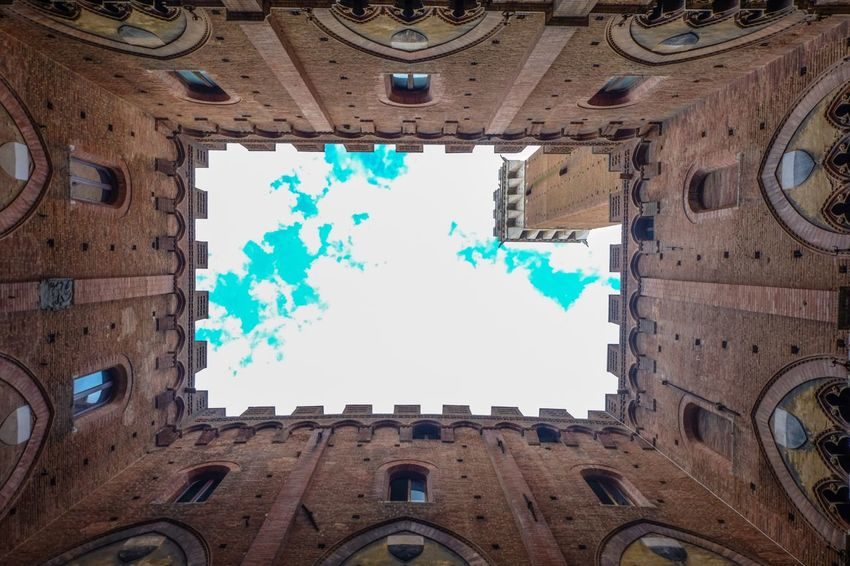 Architecture Low Angle View Building Exterior Built Structure Cloud - Sky Blue Sky No People Multi Colored Outdoors Day Tree City at Siena, Italy EyeEmNewHere Art Is Everywhere The Architect - 2017 EyeEm Awards Neighborhood Map