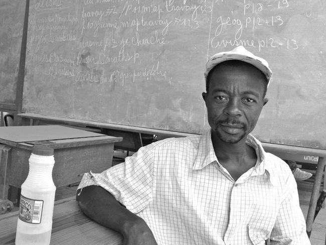 A worker taking a break in Port-au-Prince, Haiti. DeLeonStrong