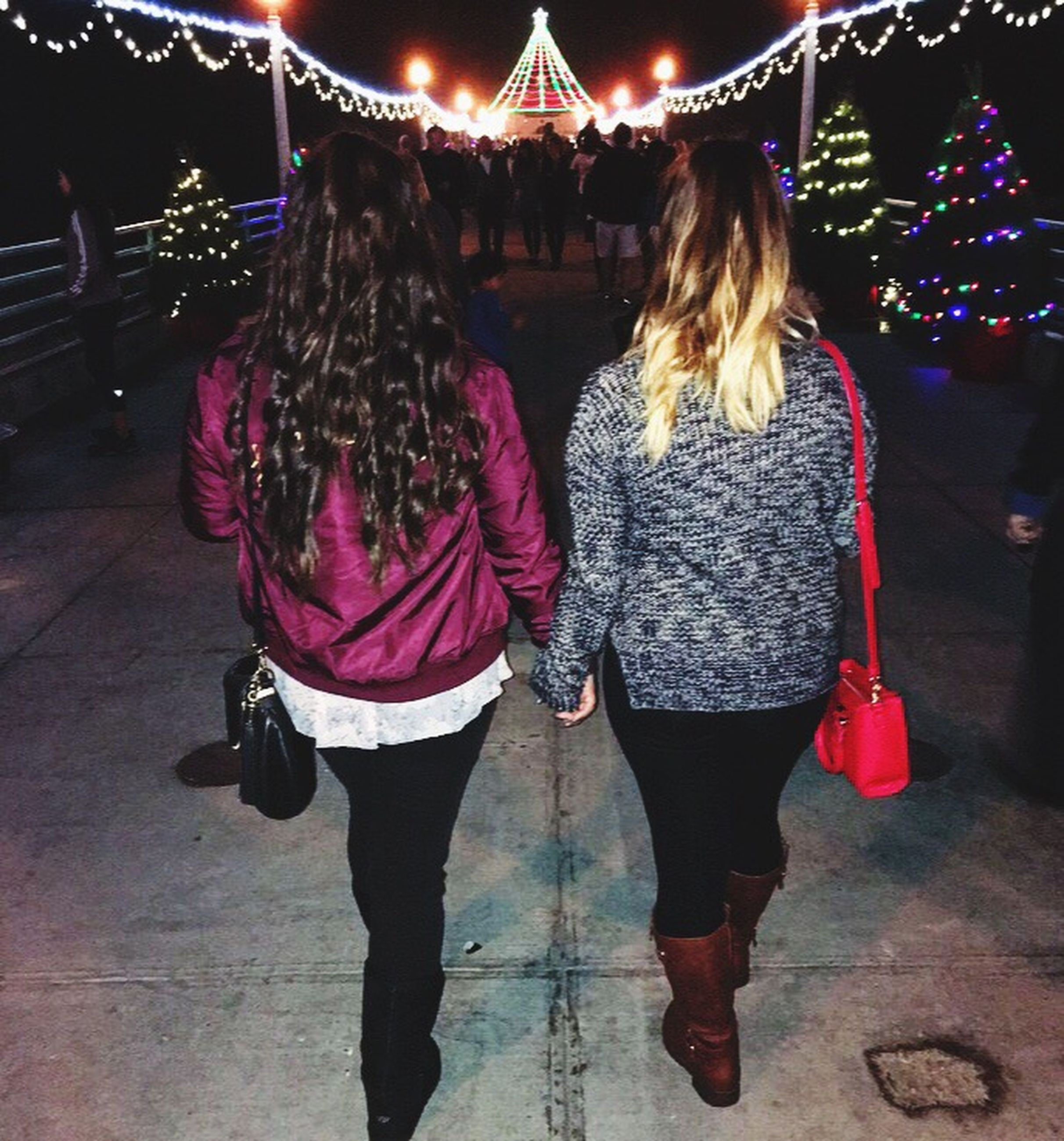 night, two people, rear view, friendship, christmas, adults only, happiness, winter, illuminated, people, togetherness, christmas lights, full length, young adult, ice rink, outdoors, young women, adult