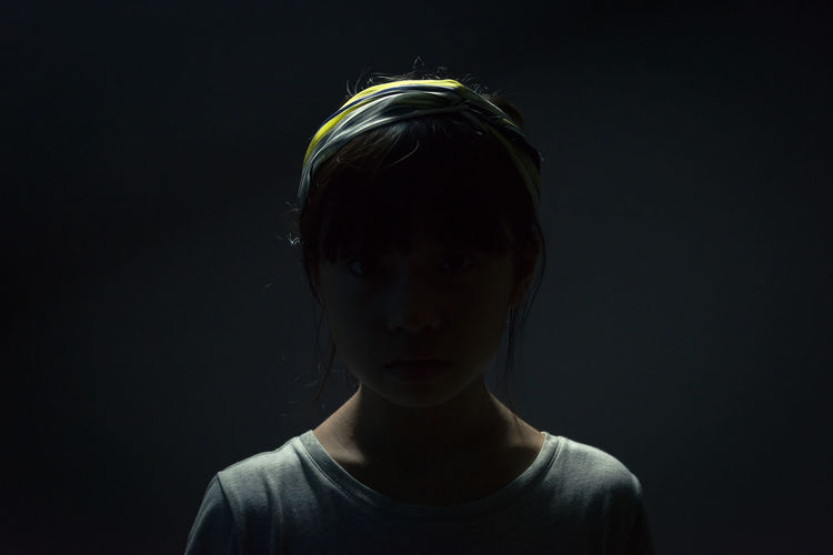 An asian girl under dark environment Anonymous Asian  Back Light Care Check This Out Helping Tragic  Unhappy Victim Abuse Black Background Bully Bullying Childhood Girl Hacker Helpme Labor Mysterious Portrait Secret Shadow Studio Shot Unfortunate Unfortunately