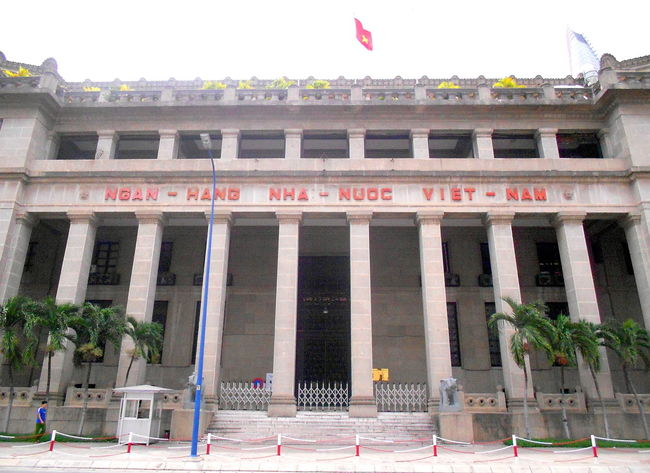 Architectural Column Architecture Building Exterior Built Structure Day Flag Government History Ho Chi Minh City No People Outdoors Patriotism Politics And Government Sky Text Travel Destinations Vietnam Travel