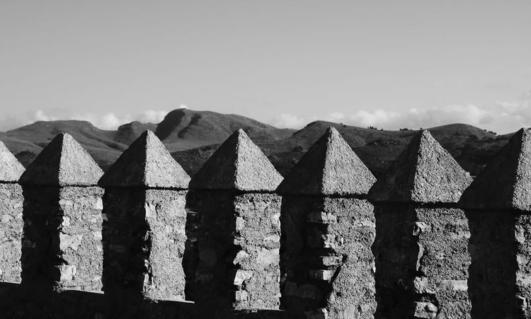 Krull&Krull Images Mallorca Architecture B&w Berge Black And White Built Structure Burg Castle Cloud - Sky In A Row Landscape Mallorca Nature No People Outdoors Repetition Scenics Sharp Sharps Side By Side Sky Spitze Sunny The Past