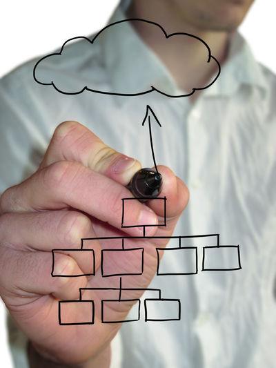 Digital composite image of businessman drawing