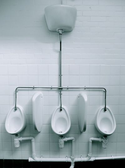 Toilet bowls attached on wall