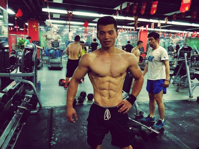 Muscular Build Exercising Sport Strength Gym Healthy Lifestyle Sports Training Shirtless Lifestyles Health Club Boxing - Sport Athlete Men Hanging Only Men Adult Sportsman Indoors  Effort Relaxation Exercise