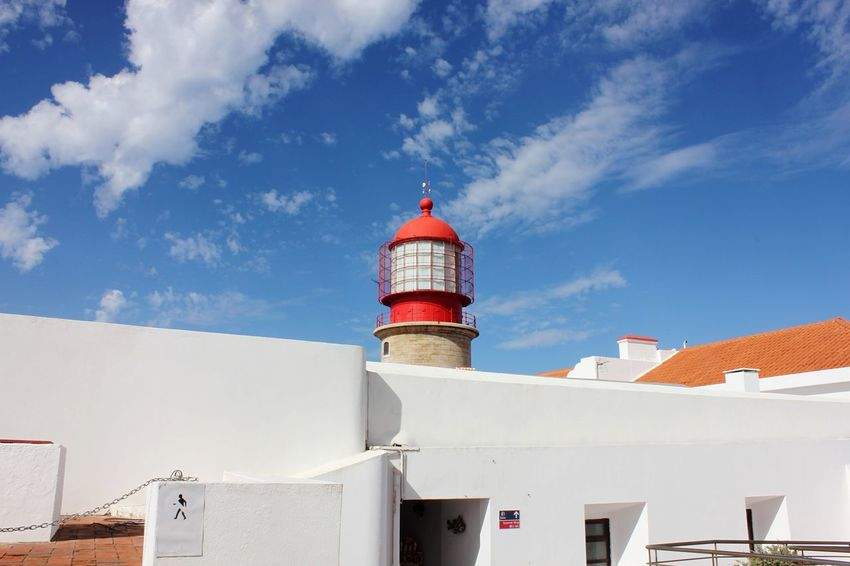 Red and white lighthouse EyeEm Selects Architecture Building Exterior Built Structure Low Angle View Sky Day White Color Cloud - Sky Outdoors No People Red Blue Whitewashed Colour Your Horizn