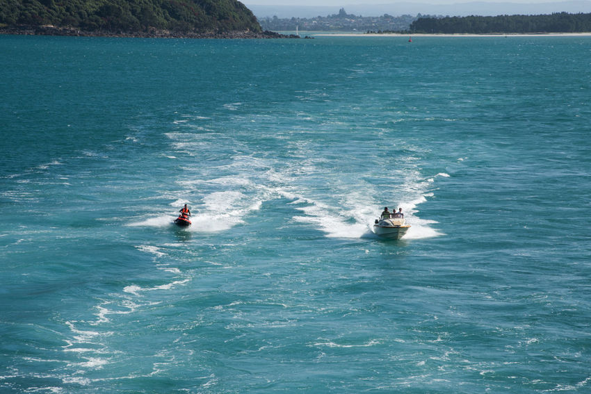 Tauranga,North Island/New Zealand-December 16,2016: People enjoying water recreation in the Pacific Ocean harbour in Tauranga, New Zealand Adrenalin Fun Harbour Jet Ski Tauranga Active Adventure Aquatic Sport Enjoying Life Fast Jet Boat Lifestyles Motion Nature Nautical Vessel New Zealand Outdoors Pacific Ocean Recreational Pursuit Sea Speed Sport Trip Water Wave Runner
