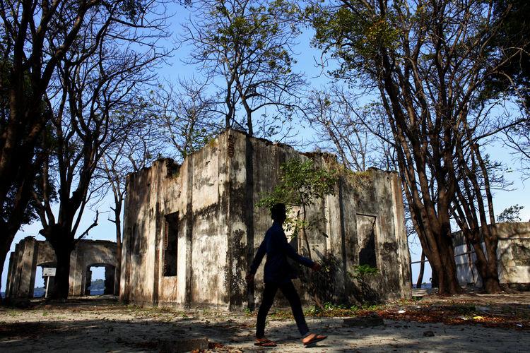Man walk at Thousand Island Jakarta Day Dutch Colonial Fort Jakarta One Person Outdoors People Pulau Cipir Ruin Sky Thousand Island Tree Walking