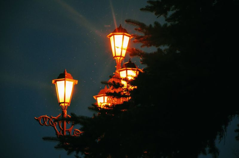 Low angle view of lamp post at night