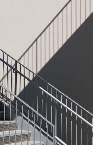 The Architect - 2017 EyeEm Awards Railing Steps And Staircases Architecture Staircase Built Structure Steps No People Day Hand Rail Outdoors Ladyphotographerofthemonth Light And Shadow Shadows & Lights Geometry Copy Space Way Up Minimalism