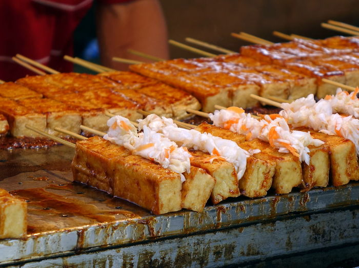 Fermented smelly tofu with pickled cabbage and spicy sauce. Food Ready-to-eat Focus On Foreground Stinky Tofu Fermented Tofu Smelly Tofu Beancurd Pickled Vegetables Pickled Cabbage Hot Sauce Spicy Sauce Taiwanese Food Street Food Skewers
