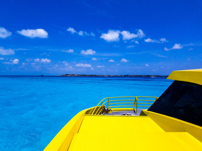 Yellow Water Blue No People Outdoors Day Sky Tranquility Scenics Beauty In Nature Nature Isla Mujeres Mexico Cloud - Sky Trapical Climate TropicalMexico Cancun Springtime Spring May 2017 Vacation Clouds Horizon Over Water Island Boat The Week On EyeEm