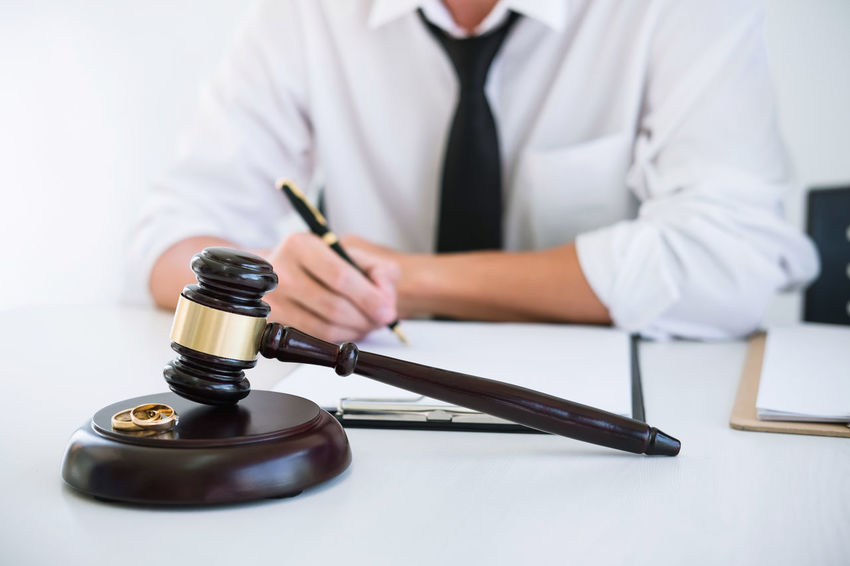 Divorce Lawyer Barrister Business Business Person Conflict Connection Fairness Focus On Foreground Gavel Hand Holding Indoors  Judge Judgement Justice Legal Men Occupation One Person Ring Signing Sitting Verdict Writing