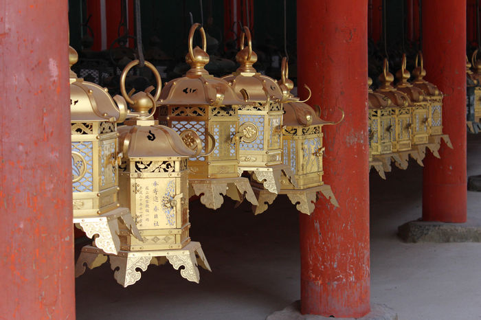 Row of gold ornate bronze lanterns in gilded as the famous point of Kasuga Grand Shrine in Nara, Japan Ancient Antique Chinese Words Day Gold Gold Colored Hanging Japanese Culture Lanterns Metal Nara,Japan No People Ornate Outdoors Place Of Worship Shrine Of Japan