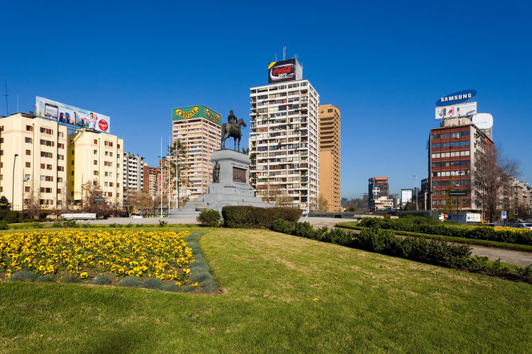 Scenic view of buildings against blue sky