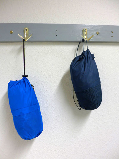 Boxing Bags Hanging On Hooks Against Wall At Home