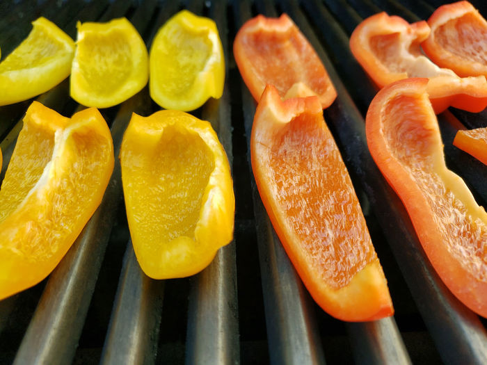 High angle view of orange fruits on barbecue