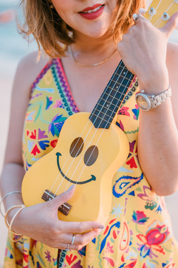String Instrument One Person Musical Instrument Women Real People Guitar Front View Musical Equipment Holding Lifestyles Midsection Adult Casual Clothing Leisure Activity Waist Up Young Women Floral Pattern Hairstyle Music Arts Culture And Entertainment Acoustic Guitar Smile Ukelele Relaxing Moments SONY A7ii