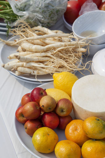 cooking festival Apple Bowl Business Finance And Industry Choice Close-up Cooking Cuisine Day Food Freshness Ginseng Healthy Eating Lemon Lime Mandarin Market No People Outdoors Radish Tangerine Vertical White Radish