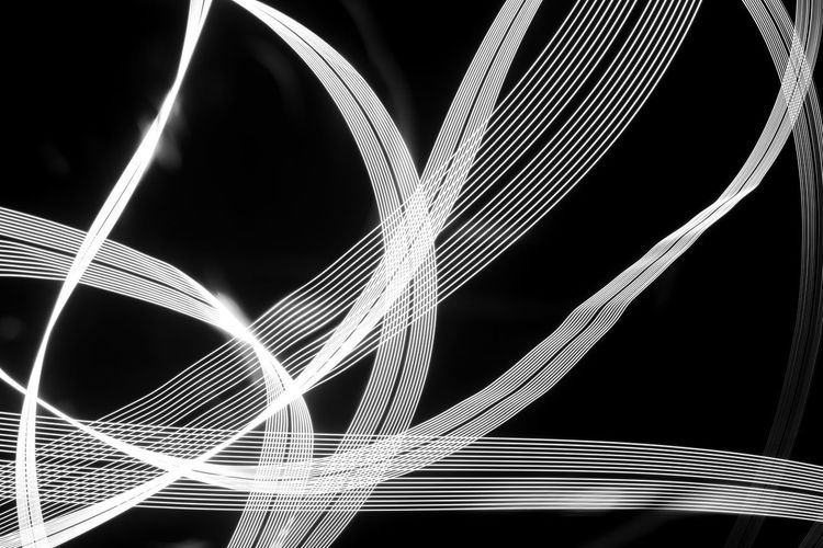 Close-up of light trails over black background