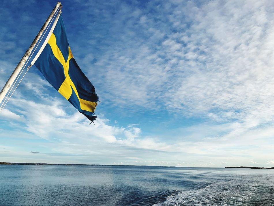 Sweden EyeEm Selects Sky Sea Water Cloud - Sky Beach Flag Horizon No People