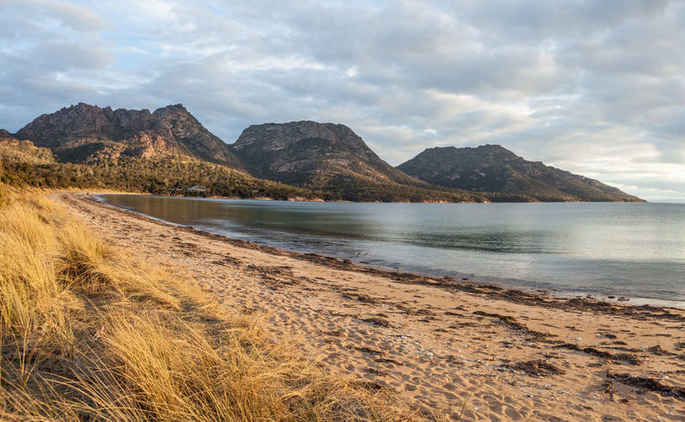 The Hazards Mountain Range viewed from Coles bay at sunset. Freycinet National Park, Tasmania, Australia Australia Australian Landscape Landscape_Collection Beauty In Nature Beauty In Nature Cloud - Sky Day Freycinet Freycinet National Park Hazards Landscape Mountain Mountain Range Nature No People Outdoors Scenics Sea Sky Tasmania Tranquil Scene Tranquility Water