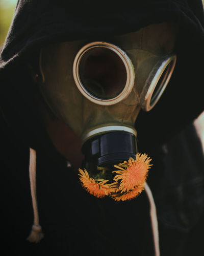 Close-up of person with gas mask