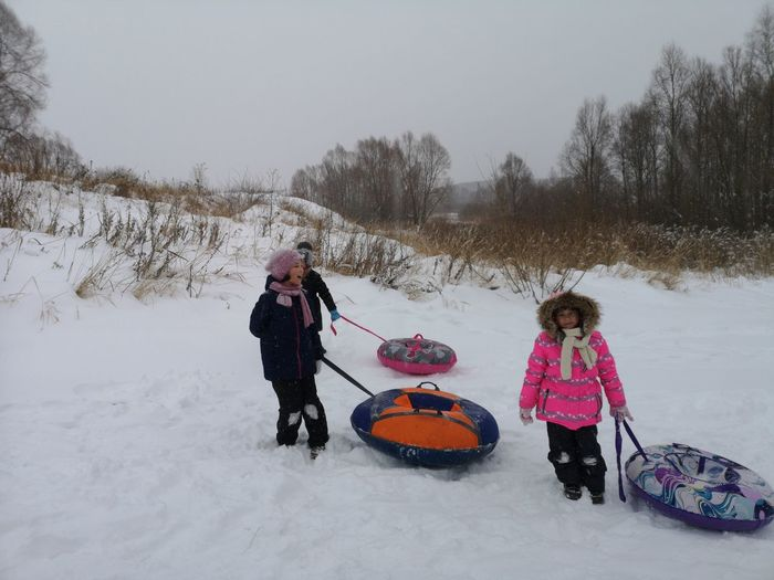 People on snowy field during winter
