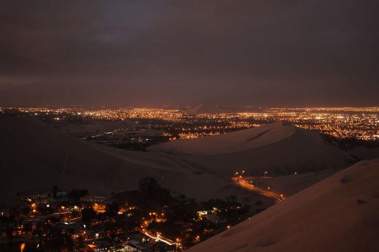 High angle view of illuminated desert at night