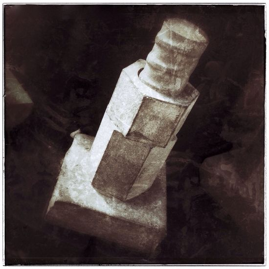 Nuts and bolt mini sculpture. Photography IPhone Industrial Abstract