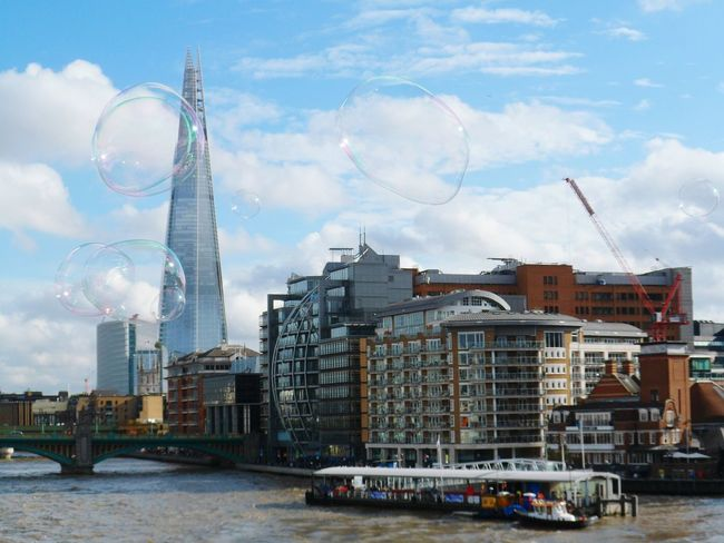 Shard bubbles Architecture Eyemphotography London Outdoors Escaping Clouds And Sky Clouds View Blue Sky Structure Skyscraper Seeing The Sights International Landmark Famous Place Travel Destinations Capital City Travel Capital Cities  No People Transportation Shard London Bridge Bubble Passenger Craft Cloud - Sky Waterfront