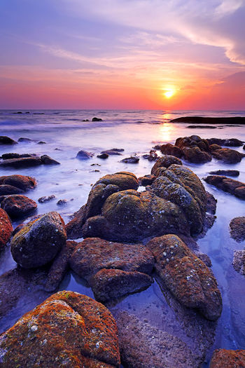 Beautiful seascape with sunset on the rocky shore of a tropical beach and Island Sea Water Sunset Rock Sky Rock - Object Solid Scenics - Nature Beach Beauty In Nature Tranquil Scene Horizon Over Water Horizon Tranquility Land Cloud - Sky Nature Idyllic Orange Color No People Outdoors Rocky Coastline Seascape Coastline Sunrise ASIA Thailand Island Beauty In Nature Tranquility Stone