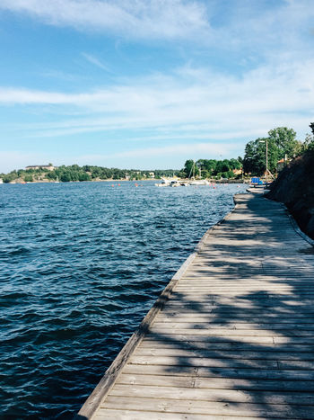 Vaxholm waterfront, Stockholm archipelago, Sweden Archipelago Coastline Distant Horizon Over Water Incidental People Jetty Nautical Vessel Outdoors Perspective Pier Rippled Sea Shore Stockholm Stockholm Archipelago Summer Summertime Sweden Vacation Vacations Vaxholm Vaxholm, Sweden Voyage Water Wood