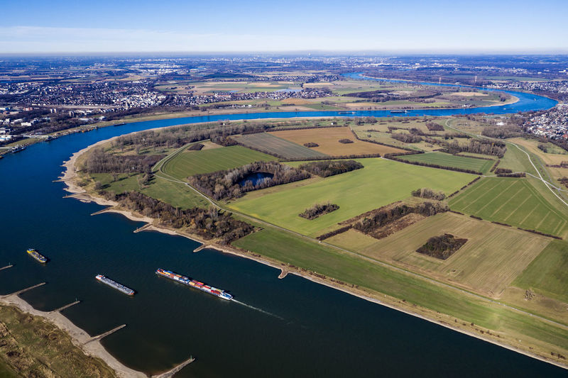first sunny hours in Rheinaue near Cologne-Worringen No People Nature Day Outdoors Dronephotography Aerial Photography Riverside Trees River Rhine River Patchwork Landscape Field Beauty In Nature Ships Sky