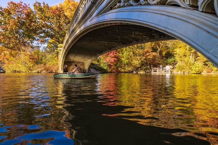 Romantic boat ride in Central Park while surrounded by fall colors. Water Transportation Tree Bridge Lake Real People Architecture Nature Arch Bridge Foliage Autumn Central Park Reflection Nature Nature_collection