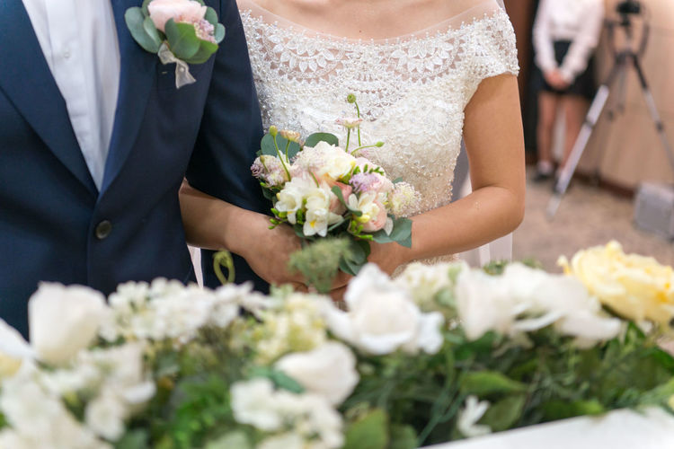 Wedding Event Celebration Bride Flower Life Events Flowering Plant Midsection Wedding Dress Adult Newlywed Married Flower Arrangement Bouquet Couple - Relationship Women Plant Love Two People Holding Wedding Ceremony Wife Husband Positive Emotion