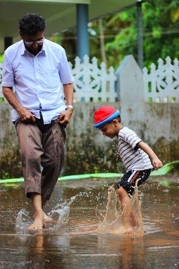 TwoIsBetterThanOne Water Spraying Lifestyles Full Length Splashing Wet Casual Clothing Enjoyment Fun Person Day Outdoors Freeze Frame Splash Highshutterspeed Waterart