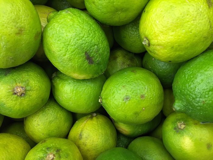 Fruit Freshness Food Healthy Eating Full Frame Green Color Lime Retail  Food And Drink Juicy Citrus Fruit Backgrounds No People Stack Large Group Of Objects Business Market Market Stall For Sale Heap Visual Feast