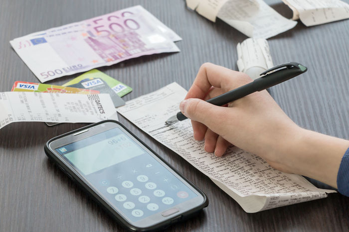 girl counts on the calculator costs Euro Tax New Life Plan Grouth Budget Cellphone Planning Salary Write Bill Calculate Calculation Calculator Cash Cheque Credit Card Euro Female Finance Holding Money Pen Phone Portable Information Device Real People Smart Phone Technology Visa Wireless Technology
