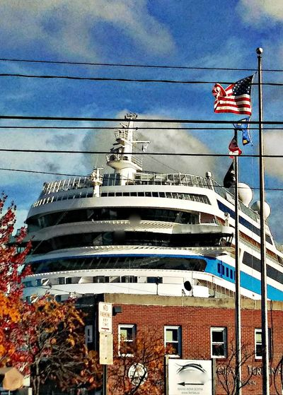 It begins... ~ Love My City Lifestyles On The Water Travel Destinations In Portland Maine USA Springtime No People Blue Color Of Life Loving The Landscape Tourism Cruise Ship Loving The Sky Economy Flag Sky Architecture Building Exterior Built Structure Boat Fluttering