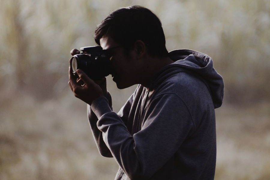 Hunter.. One Man Only Only Men Adults Only One Person Adult People Holding Side View Men Outdoors Young Adult Day Hooded Shirt Camera - Photographic Equipment Photographer Human Body Part Close-up Human Hand Headshot Portrait Silhouette Photographing Photography Themes