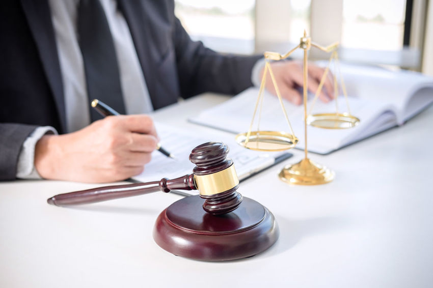 Lawyer Balance Barrister Body Part Business Business Person Consultant Fairness Formalwear Gavel Hand Holding Human Body Part Human Hand Indoors  Judge Judgement Justice Legal Legislation Men Occupation One Person Sitting Verdict