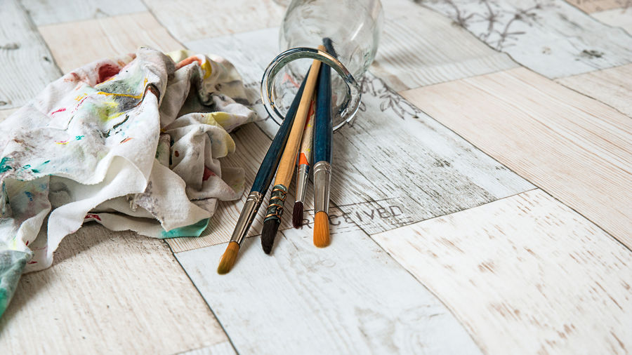 Paintbrushes and dirty cloth on vintage wooden background Art And Craft Artist Creativity Paint Tempera Colorful Equipment Paintbrush Painting Vintage Background Watercolor Watercolor Painting Wooden Background